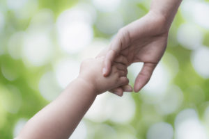 Mother and child holding hands for a soul 2 soul healing